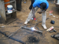 Ghana: Welder operating in a GIZ-supported industrial zone in Ghana. GIZ is supporting the development of these zones both in terms of infrastructural improvements such as electricity connection as well as business trainings of the entrepreneurs. <br />