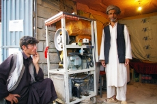 Afghanistan: Ice cream vendor in Chatta, Northern Afghanistan. The electricity he uses is supplied by a micro-hydro project supported by GIZ. <br />